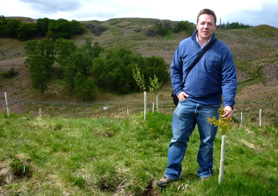 Angus Crabbie, Director of Trees4Scotland, at the newly planted Teaghlach Wood